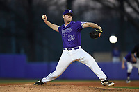 Closer Tyler Kimbrell (35) of the Furman Paladins delivers a pitch in game two of a doubleheader against the Harvard Crimson on Friday, March 16, 2018, at Latham Baseball Stadium on the Furman University campus in Greenville, South Carolina. Furman won, 7-6. (Tom Priddy/Four Seam Images)