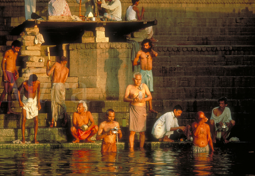 People bathing in the sacred Ganges River, Varanasi (aka Banaras or Benares), India. men, religions, customs, traditions, Hinduism. Varanasi Uttar Pradesh India Asia.