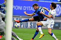 Inter Milan's Andrea Pinamonti, center, kicks to score as he is challenged by Sampdoria's Tommaso Augello during the Italian Serie A football match between Inter Milan and Sampdoria at Milan's Giuseppe Meazza stadium, May 8, 2021.<br /> UPDATE IMAGES PRESS/Isabella Bonotto