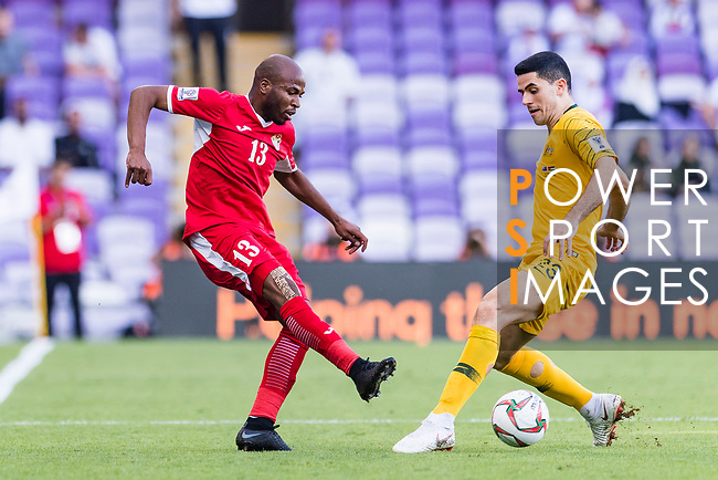 Khalil Baniateyah of Jordan (L) battles for the ball with Tom Rogic of Australia during the AFC Asian Cup UAE 2019 Group B match between Australia (AUS) and Jordan (JOR) at Hazza Bin Zayed Stadium on 06 January 2019 in Al Ain, United Arab Emirates. Photo by Marcio Rodrigo Machado / Power Sport Images