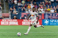 FOXBOROUGH, MA - JUNE 23: Kyle Duncan #6 of New York Red Bulls brings the ball forward during a game between New York Red Bulls and New England Revolution at Gillette Stadium on June 23, 2021 in Foxborough, Massachusetts.
