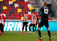 1st October 2020; Brentford Community Stadium, London, England; English Football League Cup, Carabao Cup Football, Brentford FC versus Fulham; Marcus Forss of Brentford celebrates scoring his sides 1st goal in the 36th  minute to make it 1-0 with Saman Ghoddos of Brentford