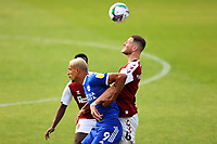 5th September 2020; PTS Academy Stadium, Northampton, East Midlands, England; English Football League Cup, Carabao Cup, Northampton Town versus Cardiff City; Fraser Horsfall of Northampton Town wins a header against Robert Glatzel of Cardiff City