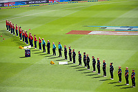The teams line up one metre apart for the national anthems before the first international women's T20 cricket match between the New Zealand White Ferns and England at Sky Stadium in Wellington, New Zealand on Wednesday, 3 March 2021. Photo: Dave Lintott / lintottphoto.co.nz