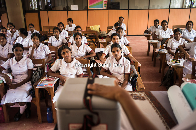 Young Sri Lankan students attend a class on vaccination in the Nursing School in Vavuniya, Sri Lanka.  Photo: Sanjit Das/Panos