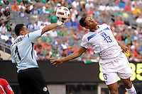 Costa Rica goalkeeper Keylor Navas (1) punches the ball away from Carlo Costly (13) of Honduras during a quarterfinal match of the 2011 CONCACAF Gold Cup at the New Meadowlands Stadium in East Rutherford, NJ, on June 18, 2011.