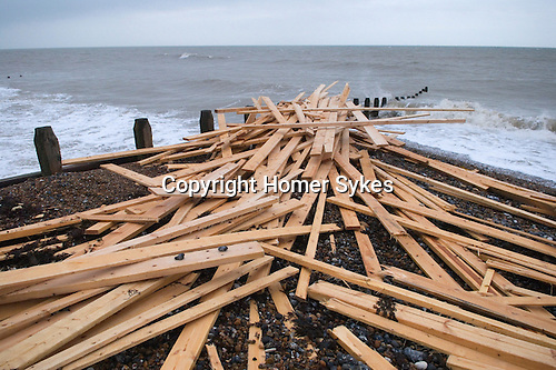 """The beach at Worthing West Sussex England. Planks of wood from the freighter the """"Ice Prince"""" which sank in rough weather on January 15th 2008"""