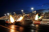 Feb. 19, 2010; Chandler, AZ, USA; NHRA top fuel dragster driver Cory McClenathan (left) races alongside Troy Buff during qualifying for the Arizona Nationals at Firebird International Raceway. Mandatory Credit: Mark J. Rebilas-