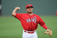 Shortstop Jonathan Ortega (29) of the Greenville Drive warms up before a game against the Delmarva Shorebirds on Friday, August 2, 2019, at Fluor Field at the West End in Greenville, South Carolina. The game was suspended in the second inning and will not be made up. (Tom Priddy/Four Seam Images)
