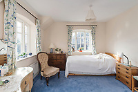 BNPS.co.uk (01202) 558833. <br /> Pic: SandersonYoung/BNPS<br /> <br /> Bedroom.<br /> <br /> A quirky 'show home' for a brickwork owner where Lewis Carroll is believed to have stayed while writing some of his Alice in Wonderland books is on the market for just under £1m.<br /> <br /> Red Cottage is a striking Grade II listed property in Whitburn, Tyne and Wear, where Charles Dodgson, otherwise known as Lewis Carroll, regularly visited family.<br /> <br /> The unusual 179-year-old home was built to show off as many design features as possible, and has a walled garden and even an air raid shelter.