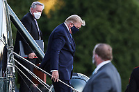 U.S. President Donald Trump exits Marine One while arriving to Walter Reed National Military Medical Center in Bethesda, Maryland, U.S., on Friday, Oct. 2, 2020. Trump will be treated for Covid-19 after being in isolation at the White House since his diagnosis, which he announced after one of his closest aides had tested positive for coronavirus infection.<br /> Credit: Oliver Contreras/ Pool via CNP/AdMedia