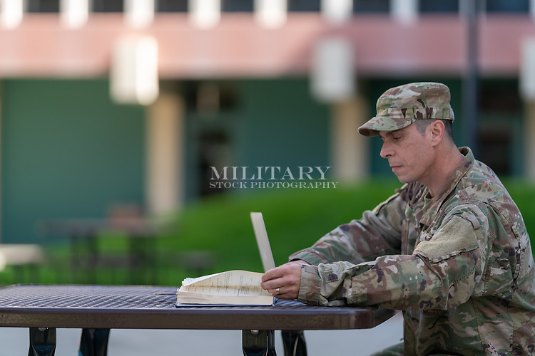 Proud US soldier in uniform on campus earning his degree,  for sale as stock photography