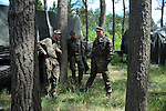 """German soldiers at the platoon command post's fire control center during a break from firing howitzers at the Drawsko Pomorskie Training Area in Poland on June 10, 2015.  NATO is engaged in a multilateral training exercise """"Saber Strike,"""" the first time Poland has hosted such war games, involving the militaries of Canada, Denmark, Germany, Poland, and the United States."""