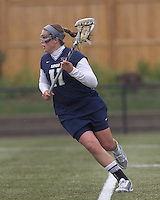 University of New Hampshire attacker Jenny Simpson (11) behind the net. Boston College defeated University of New Hampshire, 11-6, at Newton Campus Field, May 1, 2012.