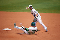 Dartmouth Big Green shortstop Justin Fowler (25) throws to first base as Tyler Dietrich (38) slides into second base during a game against the South Florida Bulls on March 27, 2016 at USF Baseball Stadium in Tampa, Florida.  South Florida defeated Dartmouth 4-0.  (Mike Janes/Four Seam Images)