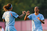 Rosana (11) of Sky Blue FC celebrates scoring on a penalty kick with Natasha Kai (6) during a Women's Professional Soccer (WPS) match against the Philadelphia Independence at Yurcak Field in Piscataway, NJ, on June 19, 2010.