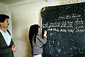 Irak 1992  Dans une école d'Halabja , une eleve au tableau  Iraq 1992 A school in Halabja, a choolgirl writing on the blackboard