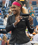 Serena Williams (USA) celebrates with a gold bracelet after her 6-3, 6-3 victory over Caroline Wozniacki (DEN) at the US Open being played at USTA Billie Jean King National Tennis Center in Flushing, NY on September 7, 2014