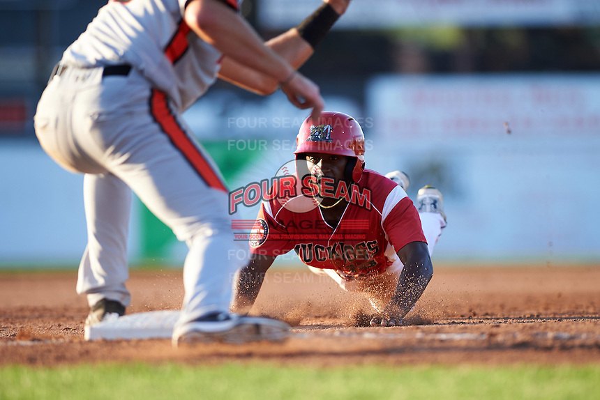 Batavia Muckdogs left fielder Isaiah White (18) slides head first into third base during a game against the Aberdeen Ironbirds on July 14, 2016 at Dwyer Stadium in Batavia, New York.  Aberdeen defeated Batavia 8-2. (Mike Janes/Four Seam Images)