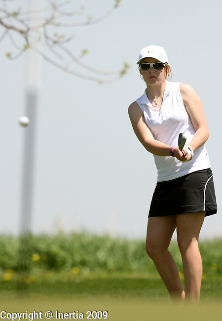SIOUX FALLS, SD - MAY 18:  Elise Nichols of Lead-Deadwood chips on the 11th green during the first round of the 2009 Class 'A' Girls Golf Tournament Monday at Central Valley in Hartford. (Photo by Dave Eggen/Inertia).
