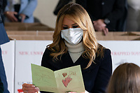 First Lady Melania Trump Participates in a Toys for Tots Christmas Event<br /> <br /> First Lady Melania Trump looks at Christmas cards to the troops written by children participating in a Toys for Tots Christmas event Tuesday, December 8, 2020, at Joint Base Anacostia-Bolling in Washington, D.C. (Official White House Photo by Andrea Hanks)