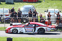 Aug 8, 2020; Clermont, Indiana, USA; Spectators cheer for the car of NHRA pro mod driver Bo Butner featuring a Donald Trump Mike Pence 2020 paint scheme during qualifying for the Indy Nationals at Lucas Oil Raceway. Mandatory Credit: Mark J. Rebilas-USA TODAY Sports