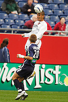 The MetroStars' Craig Ziadie goes up for a header as  the New England Revolution's Taylor Twellman watches. The New England Revolution tied the NY/NJ MetroStars one all at Gillette Stadium, Foxborough, MA, on May 22, 2004.