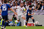Minamino Takumi of Japan (R) fights for the ball with Seyed Ashkan Dejagah of Iran (C) during the AFC Asian Cup UAE 2019 Semi Finals match between I.R. Iran (IRN) and Japan (JPN) at Hazza Bin Zayed Stadium  on 28 January 2019 in Al Alin, United Arab Emirates. Photo by Marcio Rodrigo Machado / Power Sport Images