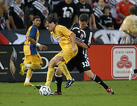 Club America midfielder Federico Insua (8) shields the ball while covered from behind by DC United defender Bobby Boswell (32). DC United defeated Club America 1-0 to secure one of the two semifinal berths in SuperLiga group B, at RFK Stadium in Washington DC, Sunday July 29, 2007.