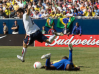 Clint Dempsey over runs the ball and a Brazil player during a USA vs Brazil international friendly which Brazil won, 4-2, at Soldier Field, Chicago, IL on September 9, 2007.
