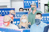 Supporters of the Republican presidential nominee Donald Trump hold Trump/Pence campaign signs during a visit by John Pence, nephew of Vice President Mike Pence and a 2020 Trump campaign senior advisor, outside the office of the New Hampshire Republican State Committee in Concord, New Hampshire, on Wed., Sept. 16, 2020. John Pence spoke to the crowd about the importance of their get out the vote efforts in securing a reelection victory for Donald Trump and Mike Pence.