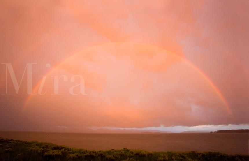Rainbow and sunset over Yellowstone Lake, Yellowstone National Park, WY