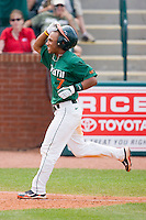 Zeke DeVoss #7 of the Miami Hurricanes celebrates his 9th inning grand slam against the Boston College Eagles as he heads towards home plate at the 2010 ACC Baseball Tournament at NewBridge Bank Park May 27, 2010, in Greensboro, North Carolina.  The Eagles defeated the Hurricanes 12-10 in 10 innings.  Photo by Brian Westerholt / Four Seam Images