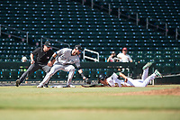 Peoria Javelinas third baseman Weston Wilson (18), of the Milwaukee Brewers organization, applies the tag to Eli White (21) as he slides into third base in front of field umpire Adam Beck during an Arizona Fall League game against the Mesa Solar Sox at Sloan Park on October 11, 2018 in Mesa, Arizona. Mesa defeated Peoria 10-9. (Zachary Lucy/Four Seam Images)