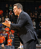 Nov. 15, 2010; Charlottesville, VA, USA; Virginia head coach Tony Bennett cheers on his players during the game against the USC Upstate Spartans at the John Paul Jones Arena.  Mandatory Credit: Andrew Shurtleff