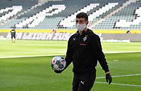 23rd May 2020, BORUSSIA-PARK, North Rhine-Westphalia, Germany; Bundesliga football, Borussia Moenchengladbach versus Bayer Leverkusen; A team ballboy wearing protective mask as he retrieves a ball for the players