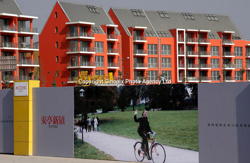 "An advertisement showing a western woman on a bicycle for Anting New Town, a satellite district of Shanghai, China. Designed by Albert Speer, son of Adolf Hitler's favorite architect, the town boasts ""German"" style and is planned to house over 30,000 people..25 Nov 2005"