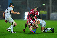 Steffan Hughes of Scarlets is tackled by Swan Rebbadj of Toulon during the European Rugby Challenge Cup Round 5 match between the Scarlets and RC Toulon at the Parc Y Scarlets in Llanelli, Wales, UK. Saturday January 11 2020