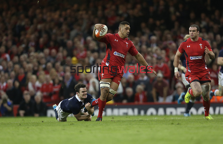 Scotland wing Max Evans does just enough to stop Wales number 8 Taulupe Faletau.<br /> RBS 6 Nations 2014<br /> Wales v Scotland<br /> Millennium Stadium<br /> <br /> 15.03.14<br /> <br /> ©Steve Pope-SPORTINGWALES