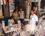 Sampaloc buri weaver Susan Bala models a buri costume for the Bulihan Festival.