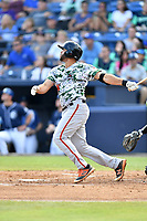 Augusta GreenJackets first baseman Jose Vizcaino (26) swings at a pitch during a game against the Asheville Tourists at McCormick Field on July 15, 2017 in Asheville, North Carolina. The Tourists defeated the GreenJackets 2-1. (Tony Farlow/Four Seam Images)