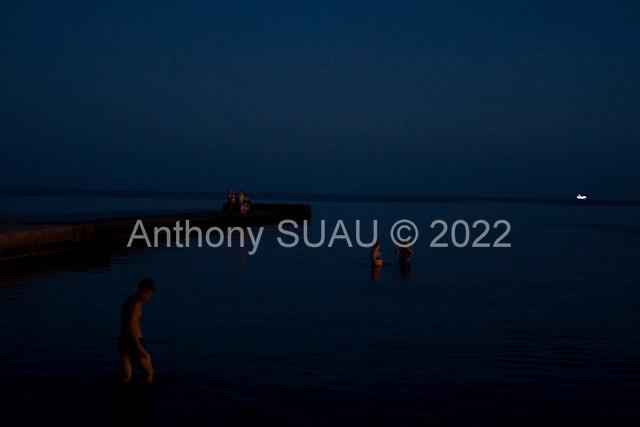 """Odessa, Ukraine<br /> August 27, 2005 <br /> <br /> Odessa's """"Arcadia"""" beach at dusk."""