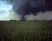 A strong tornado churns across farmland near Woonsocket South Dakota on June 24th, 2003. This storm was part of a weather system that spawned the largest single-day outbreak of tornadoes in the state's history.