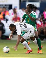 KANSAS CITY, KS - JUNE 26: Sheldon Holder #9 defends against Leston Paul #23 during a game between Guyana and Trinidad