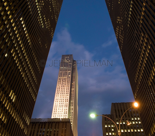 AVAILABLE FOR LICENSING FROM PLAINPICTURE.  Please go to www.plainpicture.com and search for image # p5690224.<br /> <br /> 30 Rockefeller Plaza (The GE Building) viewed at Dusk from West 49th Street, Midtown Manhattan, New York City, New York State, USA