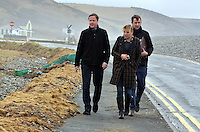 Pictured: Prime Minister David Cameron (L) walking by the storm damaged coastal road in Newgale, Pembrokeshire. Wednesday 19 February 2014<br />