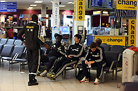 Wednesday 07 August 2013<br /> Pictured L-R: Roland Lamah talks to team mates Wilfried Bony, Ki SUng Yueng and Ben Davies at Cardiff Airport.<br /> Re: Swansea City FC travelling to Sweden for their Europa League 3rd Qualifying Round, Second Leg game against Malmo.