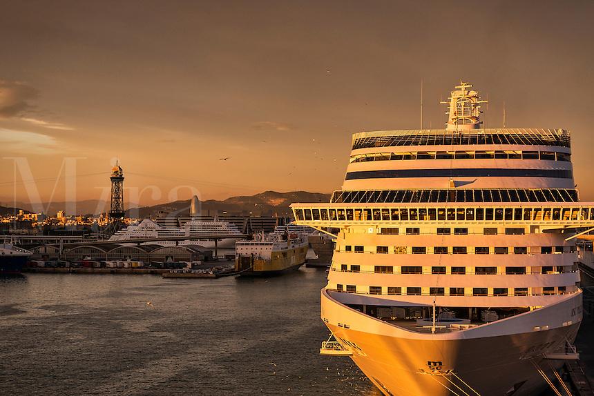 Sunset cruise ship docked in harbor, Barcelona, Spain