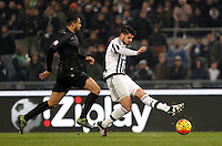 Calcio, quarti di finale di Coppa Italia: Lazio vs Juventus. Roma, stadio Olimpico, 20 gennaio 2016.<br /> Juventus' Alvaro Morata, right, kicks the ball as he is challenged by Lazio's Mauricio during the Italian Cup quarter final football match between Lazio and Juventus at Rome's Olympic stadium, 20 January 2016.<br /> UPDATE IMAGES PRESS/Isabella Bonotto