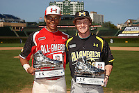Jan Hernandez #11 and Clint Frazier #19 show their MVP trophies after the Under Armour All-American Game powered by Baseball Factory at Wrigley Field on August 18, 2012 in Chicago, Illinois.  (Mike Janes/Four Seam Images)